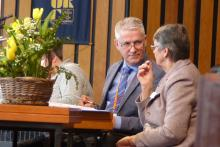 The Deputy Moderator and the Synod Clerk consult over procedure